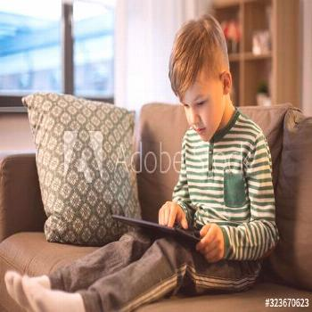 childhood, technology and people concept - happy little boy with tablet pc computer at home ,