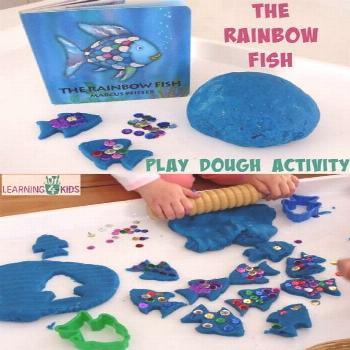 The Rainbow Fish by Marcus Pfister inspired activity - using play dough and sequins to re-create th