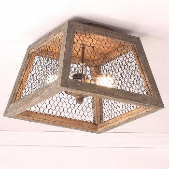 Weathered wood and chicken wire ceiling light blends the vintage charm of rustic French villas with
